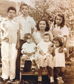 Juana as a young girl leaving Nicaragua with her mother Maria and her brothers and sister